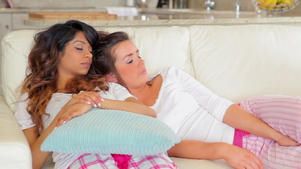 Women lying on the couch sleeping