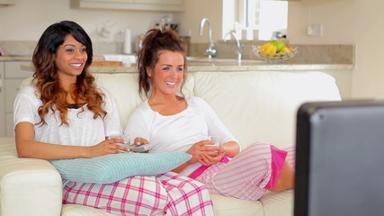 Woman sitting on the couch watching tv