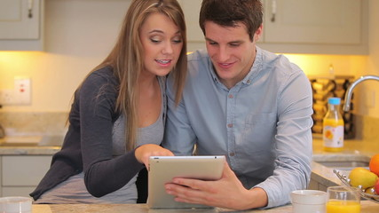 Couple using video chat on tablet pc