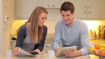 Man showing woman something on tablet pc