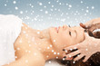 beautiful woman in massage salon with snow