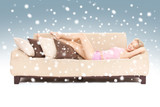 sleeping woman on sofa with snow