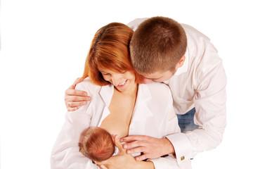 . Parents admiring the newborn  Family concept.