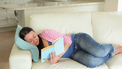 Pregnant woman enjoying reading a book