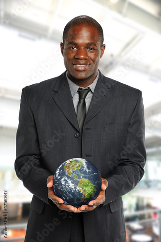 Young African American Businessman holding the earth