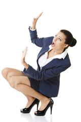 Scared businesswoman defending herself