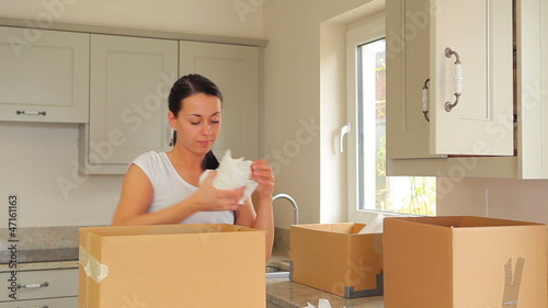 Woman unpacking after move