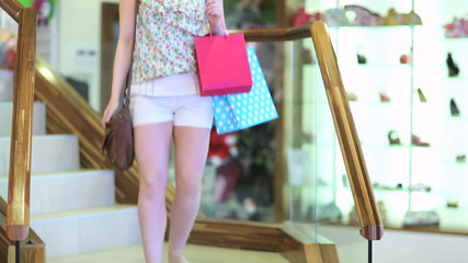 Woman going downstairs in shopping mall