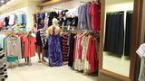Woman picking up dress and looking in mirror