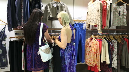 Women looking at dresses