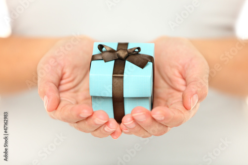 Female hands holding a gift