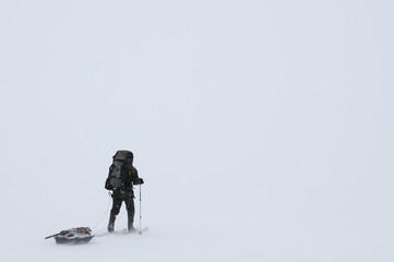 hiker in snowstorm