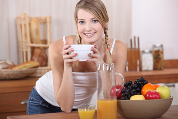 Woman having breakfast.