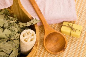 Sauna accessories on bamboo mat