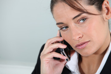 Businesswoman holding mobile telephone