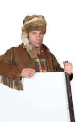 Man in trapper costume