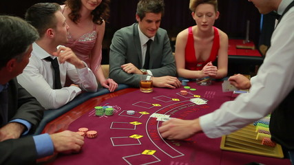 People playing blakcjack at the casino