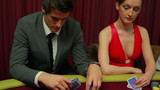 Woman cheating at poker table