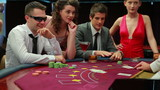 Man in sunglasses winning at blackjack