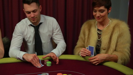 Two people left in poker game and woman winning