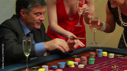 Man smoking a cigar wins at roulette