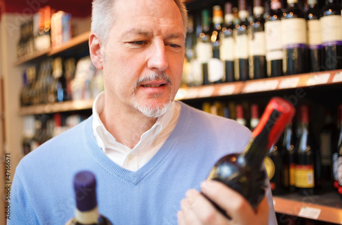 Man comparing two wines
