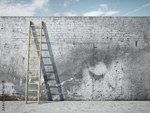 Ladder on wall in front of sky - 47166744