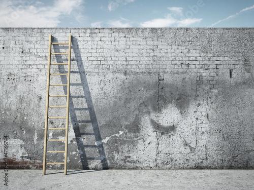 Foto op Plexiglas Wand Ladder on wall in front of sky