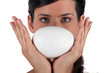 Female holding a bar of soap