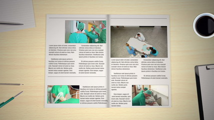 Hand turning pages of medical news magazines