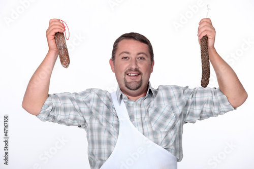 butcher holding fresh sausages