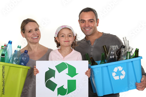 Family recycling bottles