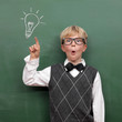 canvas print picture - Schoolboy at the Blackboard with Idea