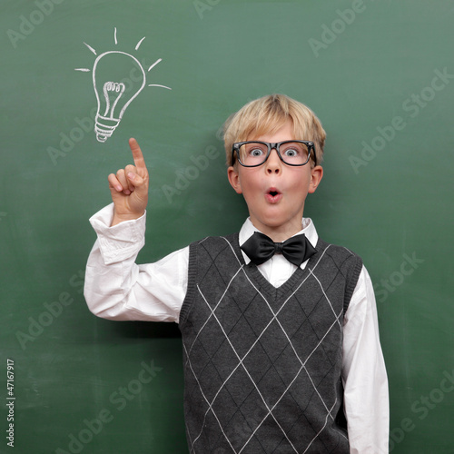 Schoolboy at the Blackboard with Idea