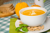 Pumpkin soup in a white plate