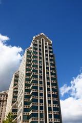 Modern Condo Tower Under Nice Skies