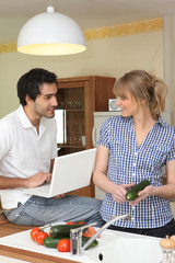 Couple in kitchen with computer