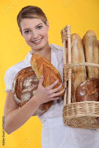 Bakery worker holding basket