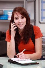 Brunette woman answering the phone