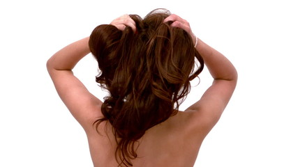 Woman shaking out her hair
