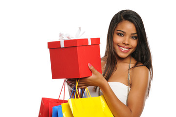 Young African American woman holdring a present and shopping bag
