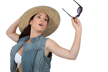 Young woman with straw hat and sunglasses