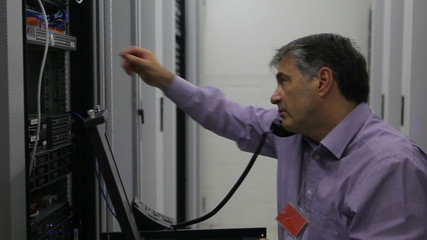 Man doing maintenance while calling