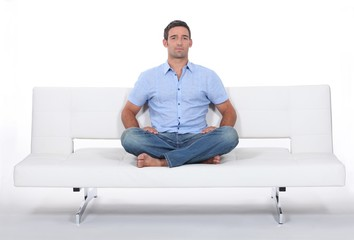 man alone on white sofa