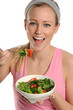 Young Blond woman holding a bowl of salad