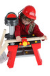 Little boy playing with carpentry toy