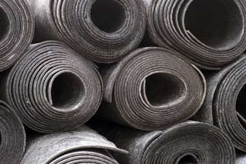 rolls of black foam