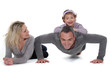 Father doing push-up with daughter on back