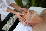 Man receiving head massage at day spa