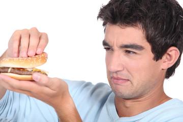 Man holding cheeseburger